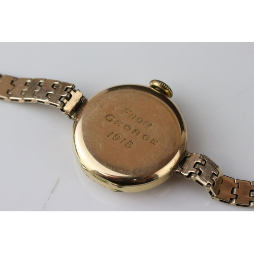 59 - Early 20th century 9ct gold cased wristwatch, gold-coloured dial, black Arabic numerals and poker ha...