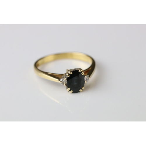 83 - Sapphire and diamond 18ct yellow gold ring, the oval mixed cut blue-black sapphire measuring approx ...