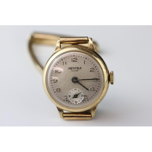 91 - 9ct gold cased ladies wristwatch, champagne dial, gold Arabic numerals, black pencil hands, 9ct gold...
