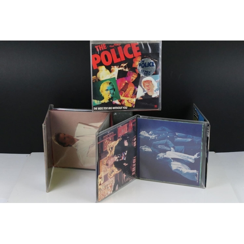 361 - Vinyl - Two The Police fold out packs AMPP6001 each containing 6 x 45s in blue vinyl, some discolour...