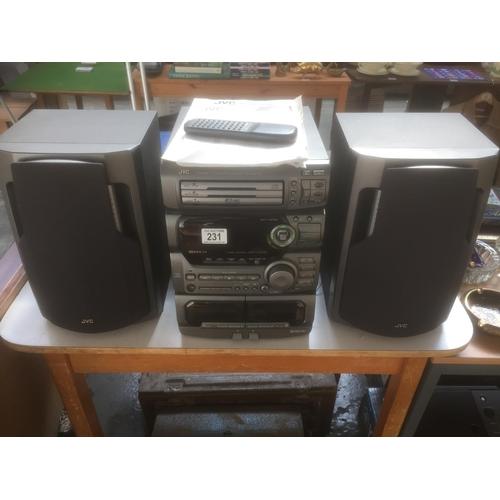 231 - JVC Stereo System & Speakers...