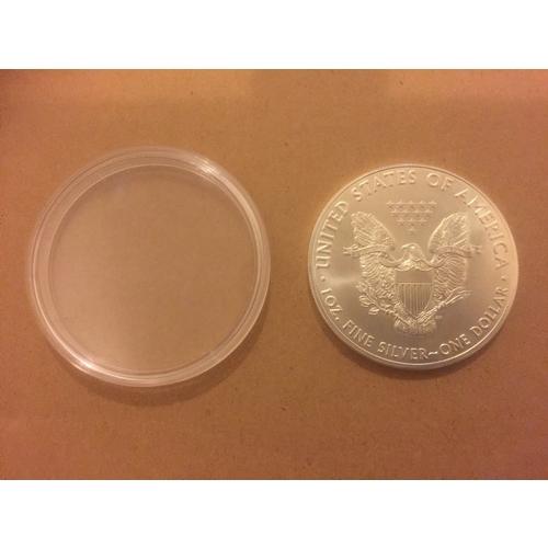 710 - 1oz Silver Dollar...