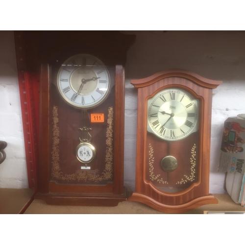 111 - 2 x Cased Wall Clocks...