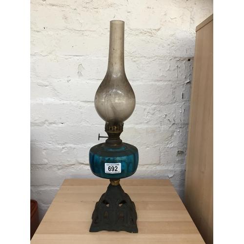 692 - Cast Base Oil Lamp...