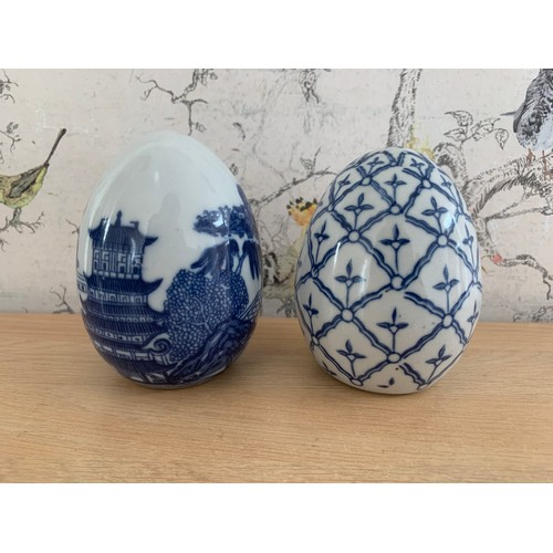 23 - 2 x Painted Blue & White Ceramic Eggs - 11cms Height