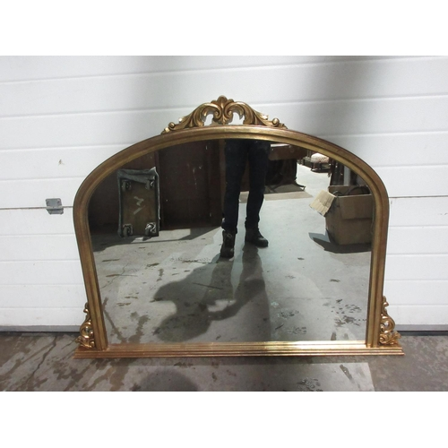 15A - A reproduction gilt framed Overmantel Mirror with scroll surmount 4ft 8in W x 3ft 6in H...