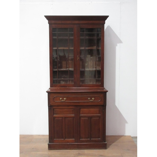 23 - A walnut Bookcase with single drawer and cupboard below 7ft H x 3ft 1in W...