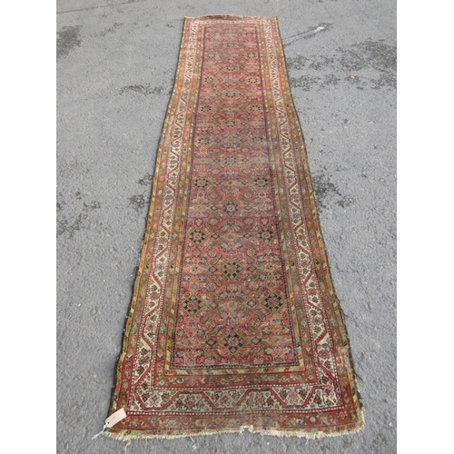 3 - A bordered Persian Runner. Approx. 138 x 35 in...
