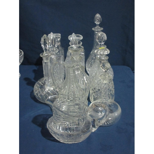 32 - Ten various Decanters, Wine Jug and a Water Jug....