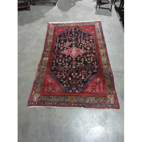 2 - A Kurdistan bordered Rug, 7ft 7in x 4ft 8in....