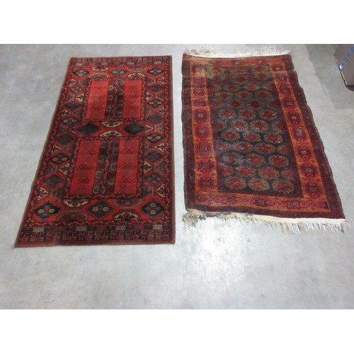 22 - A Belgian Rug, 5ft 3in x 2ft 10in and a Persian Rug, 5ft x 3ft....