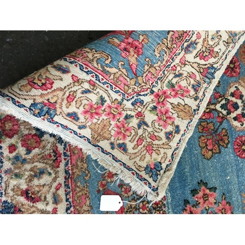 17 - A cream ground Rug with blue central decoration and border 6ft 4in L x 4ft 6in W and a small blue Ru...