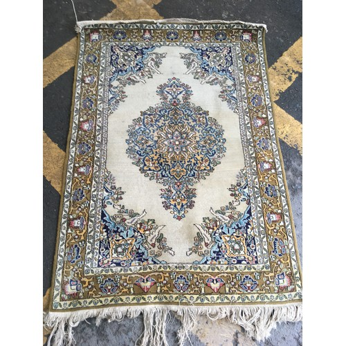23 - A cream ground Rug with central floral motif within border with stylised floral design 5ft 4in L x 3...