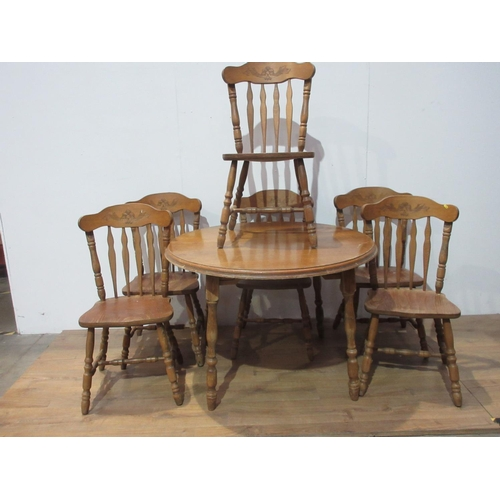 125 - A modern pine circular Dining Table 3ft 9in W with spare leaf and six Chairs...