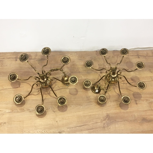 137 - A pair of Dutch brass eight branch electroliers 2ft 1/2in D x 1ft 1in L...