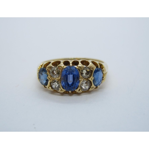 184 - A late 19th Century Sapphire and Diamond Ring pave-set three graduated oval-cut sapphires with pairs...