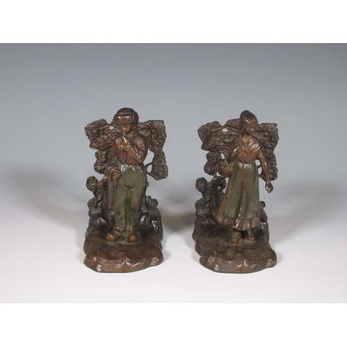 257 - A pair of bronzed cast metal figural Bookends of Dutch Boy and Girl...