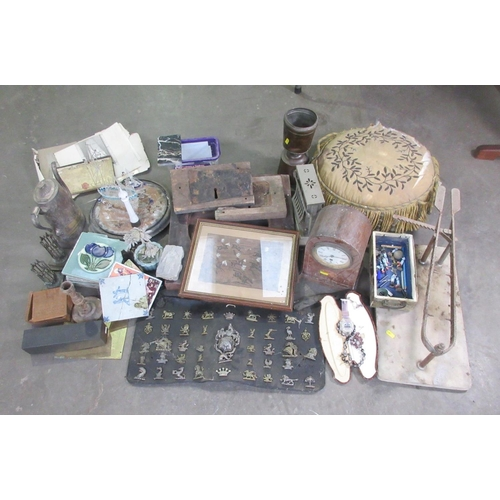 26 - Two boxes containing British Army Cap Badges, Mantel Clock, old Photographs, silk embroidered Pouffe...