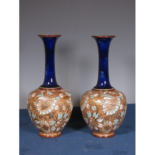 269 - A pair of Royal Doulton club shaped Vases with floral design om a gilt ground...