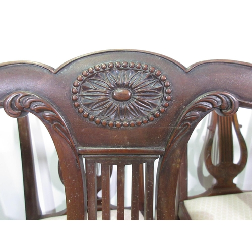 373 - A set of seven reproduction mahogany Dining Chairs with harp backs...