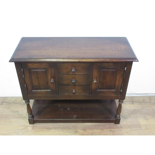 401 - A reproduction oak Side Cupboard fitted pairof panelled doors flanking three drawers 3ft W...