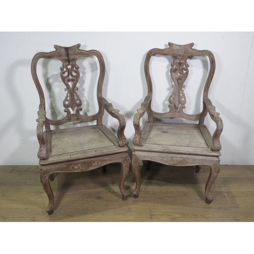 406 - A pair of limed hardwood Elbow Chairs with solid seats 3ft 6in H...