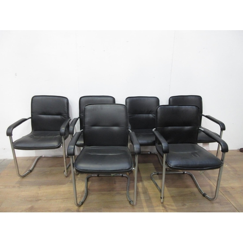 410 - A set of six metal framed Chairs with black leather upholstery...