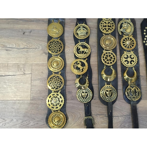 422 - A collection of Horse Brasses on leather straps...