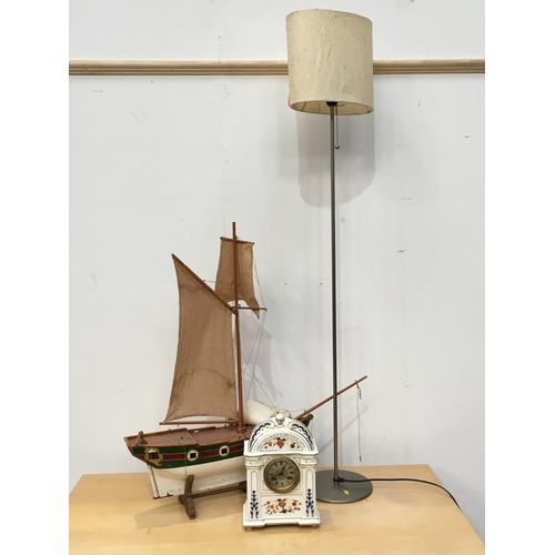 477 - A French ceramic Mantel Clock A/F 1ft H, a Model of a Sailing Boat and a modern Standard Lamp (passe...