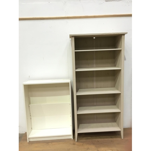 522 - A cream coloured open Bookcase, 6ft h x 3ft w x 1ft 4in deep, and another smaller...
