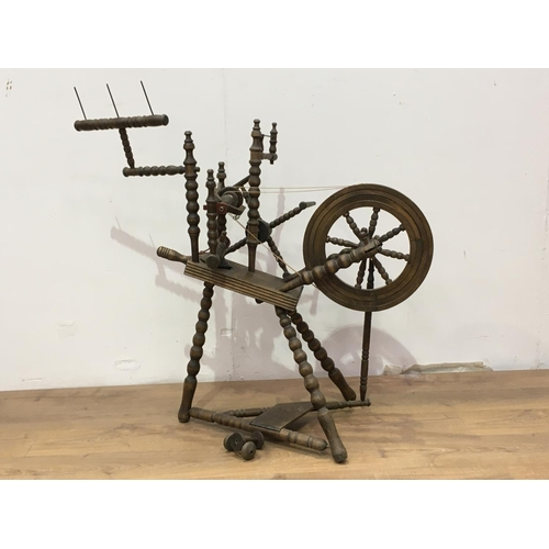 527 - A turned wood Spinning Wheel, 3ft 4in H