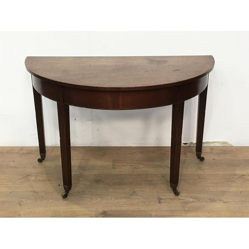 531 - A 19th Century mahogany demi-lune Side Table with squared supports and casters, 3ft 9in W...
