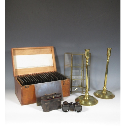 702 - A glass and brass table top Cabinet, a pair of brass Candlesticks, box of glass Slides and a pair of...