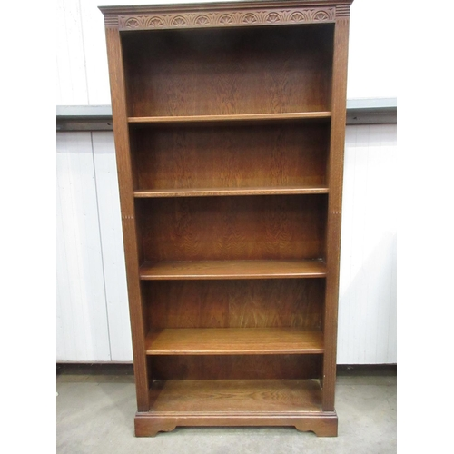 736 - A reproduction oak open Bookcase with fixed shelves 6ft 5in H x 3ft 4in W...