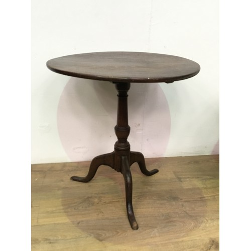 539 - A 19th Century oak tilt-top Table with turned column and tripod base, 2ft 2in diam...