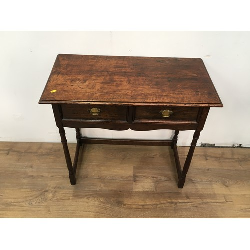 615 - An 18th Century style oak Side Table fitted two drawers mounted upon turned supports 2ft 7in W x 2ft...