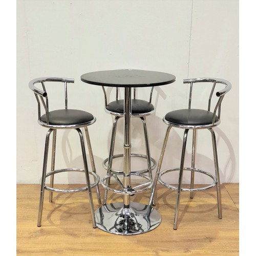 90 - A modern stainless steel Pedestal Table and three Bar Stools....