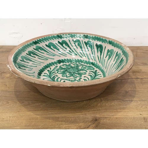 676 - A large antique green and white glazed pottery Letting Bowl 2ft 1/2in W...