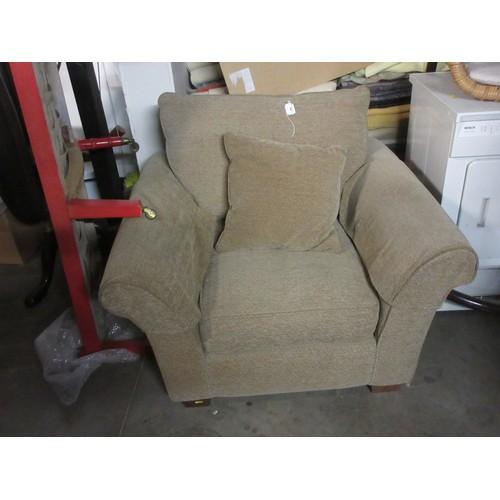 569 - A beige upholstered Armchair with herringbone design...
