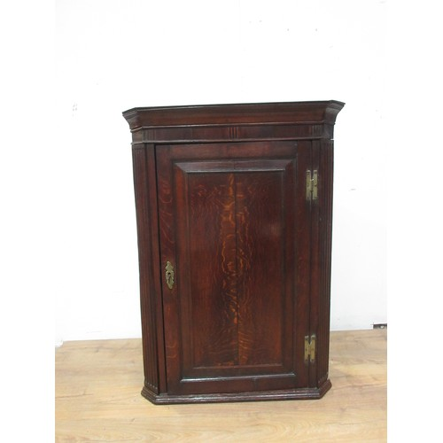 334 - An antique oak Hanging Corner Cupboard with single door enclosing shaped shelves, 3ft 6in H...
