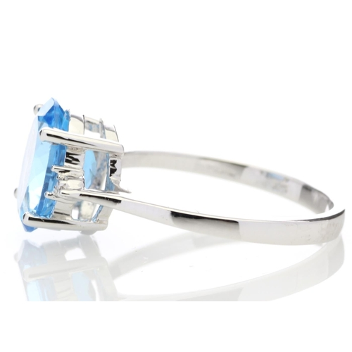 18180050L - Valued by GIE £900.00 - 9ct White Gold Diamond And Blue Topaz Ring 0.01 Carats, Colour-D, Clarity-VS...