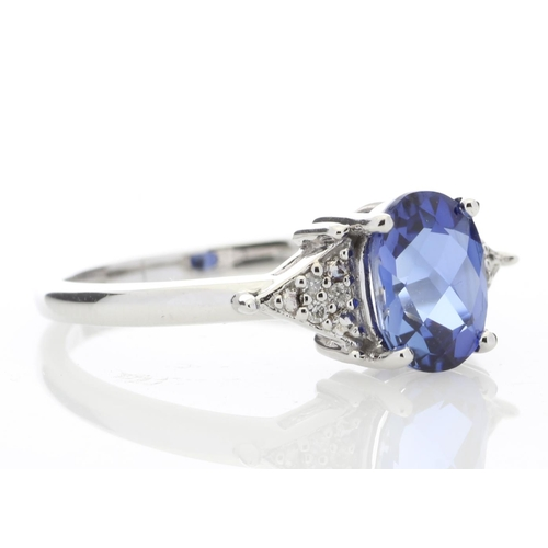 55 - Valued by GIE £1,295.00 - 9ct White Gold Created Ceylon Sapphire and Diamond Ring (0.03) 1.67 Carats...