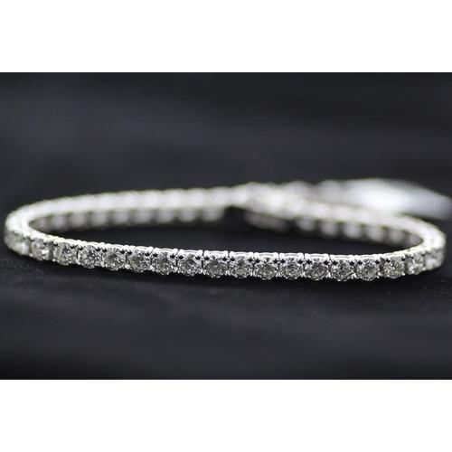 24 - Valued by GIE £65,000.00 - 18ct White Gold Tennis Diamond Bracelet 7.14 Carats, Colour-D, Clarity-VS...
