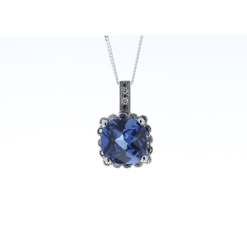 105 - Valued by GIE £1,360.00 - 9ct White Gold Created Ceylon Sapphire Diamond Pendant 0.05 Carats, Colour...