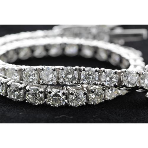 45 - Valued by GIE £65,000.00 - 18ct White Gold Tennis Diamond Bracelet 7.14 Carats, Colour-D, Clarity-VS...
