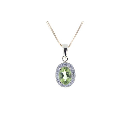 66 - Valued by GIE £1,020.00 - 9ct Yellow Gold Diamond And Peridot Pendant 0.11 Carats, Colour-D, Clarity...