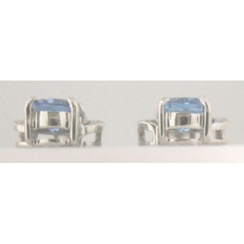 87 - Valued by GIE £950.00 - 9ct White Gold Diamond And Blue Topaz Earring 0.02 Carats, Colour-D, Clarity...