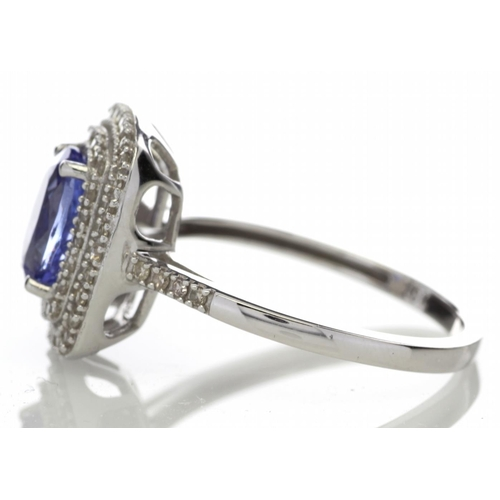 31 - Valued by GIE £3,105.00 - 9ct Gold Oval Tanzanite And Diamond Cluster Ring 0.33 Carats, Colour-D, Cl...