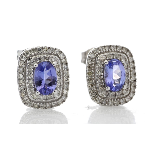 33 - Valued by GIE £2,975.00 - 14ct White Gold Oval Diamond And Tanzanite Earring 0.35 Carats, Colour-D, ...