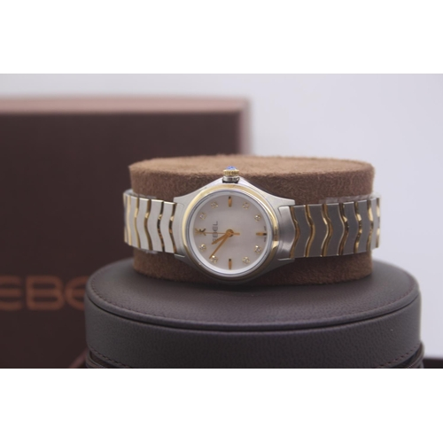 2 - BOXED BRAND NEW EBEL LADIES BI MTEL GOLD AND STEEL WRIST WATCH COMPLETE WITH MOTHER OF PEARL DIAMOND...